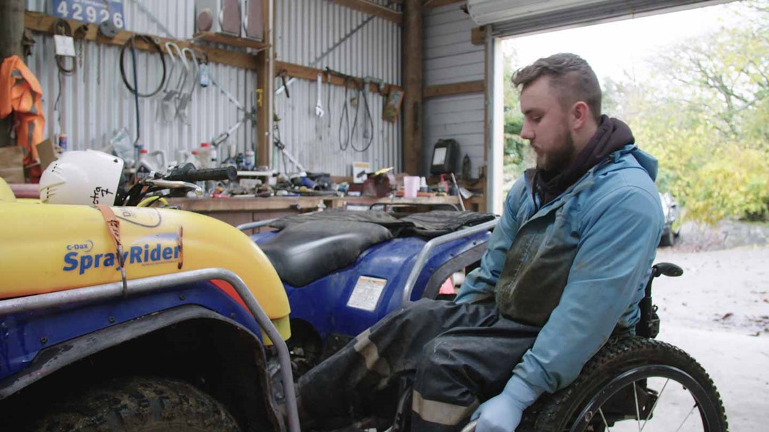 Jack in his shed tending to a quadbike.